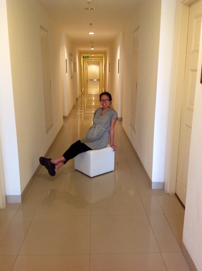 Jammie in a far better state today, reenacting last night's ottoman hallway transport...